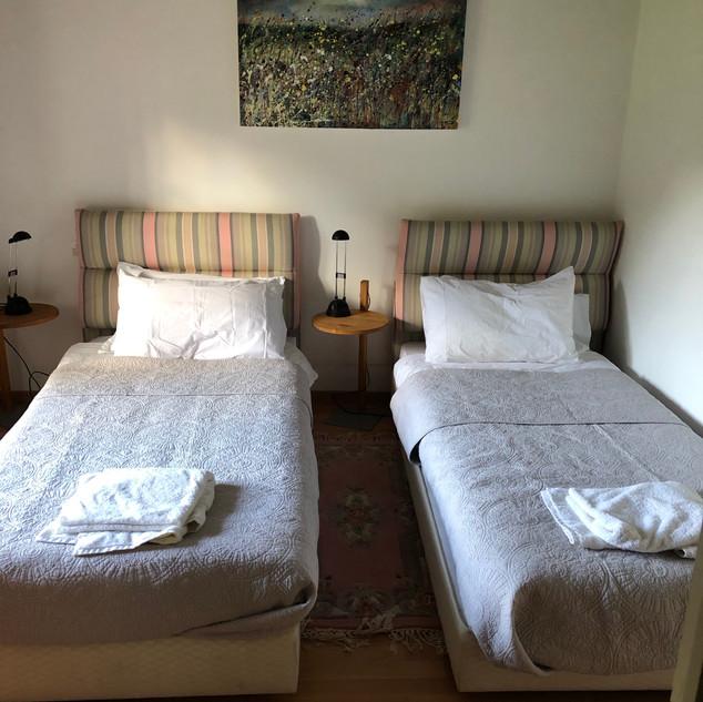 Ochre bedroom twin beds ensuite
