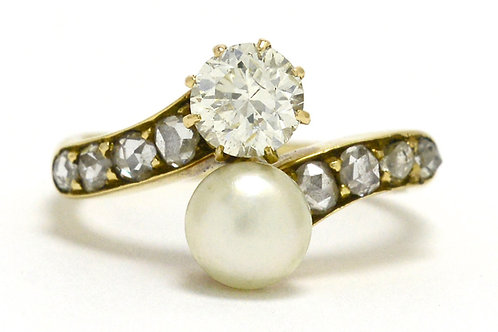 A diamond and button pearl 2 gem engagement ring