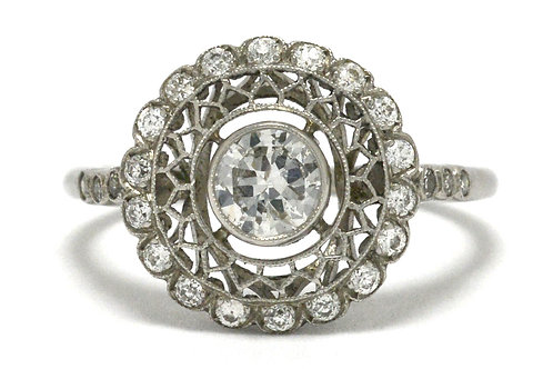 An engagement ring diamond crafted of platinum in a spider web halo design