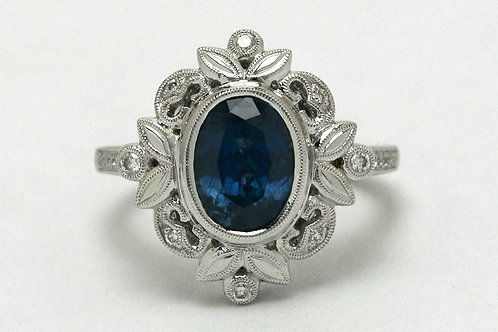A stunning oval natural Montana blue sapphire engagement ring crafted of 18K white gold