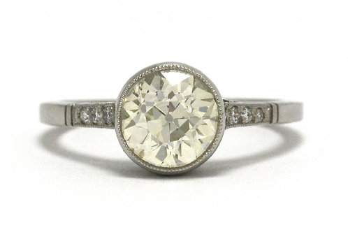 An old mine brilliant diamond solitaire engagement ring set in platinum