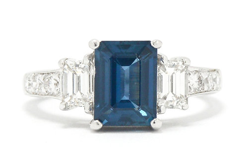 A sapphire and diamond 3 stone ring