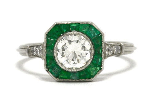 A round transitional brilliant diamond and emerald halo accent engagement ring