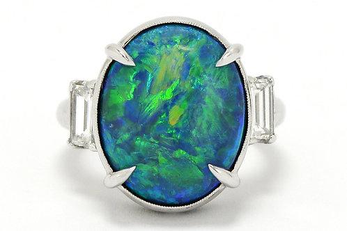 Platinum oval black opal engagement ring