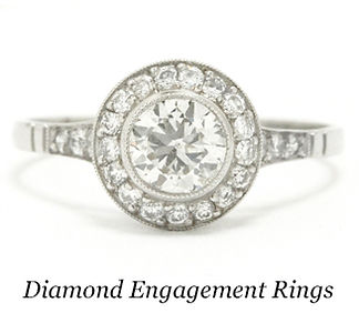 A platinum diamond halo engagement ring.