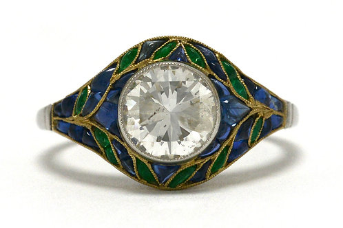 A transitional round brilliant diamond platinum gold engagement ring