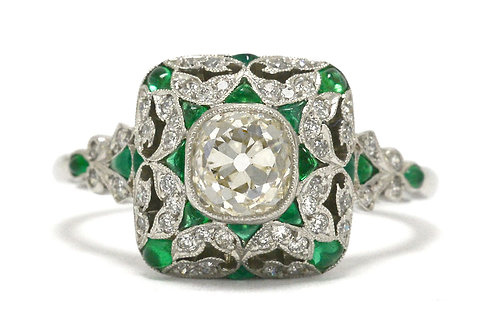 A 1 carat old mine cushion diamond emerald engagement ring