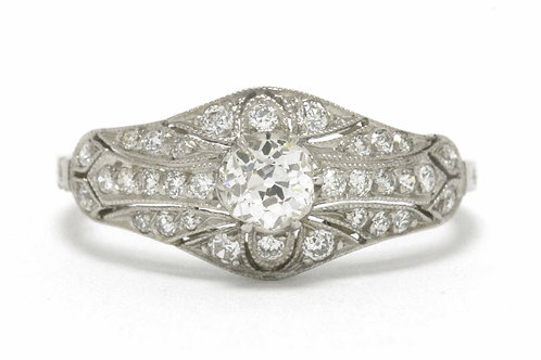 An old mine cut round cushion diamond is set in this antique engagement ring