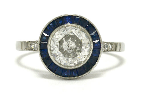 Art Deco engagement ring featuring an old European diamond sapphire halo