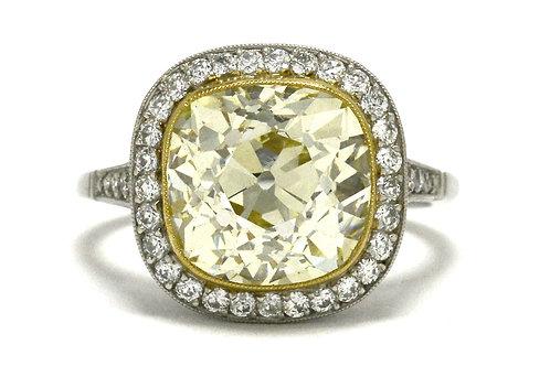 A giant 5 and half carat old mine cushion diamond halo platinum engagement ring