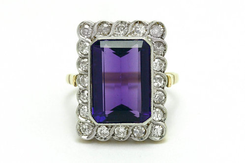 An Edwardian amethyst engagement ring accented by a halo of diamonds