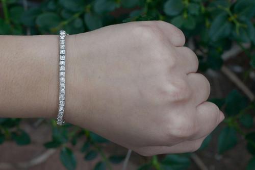 c9e683cd861 A classic 18k white gold diamond tennis bracelet with diamonds encircling  the entire design A square link white gold tennis bracelet