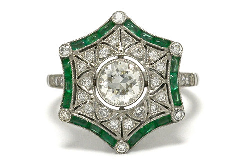 This engagement ring is a emerald diamond halo platinum snowflake design