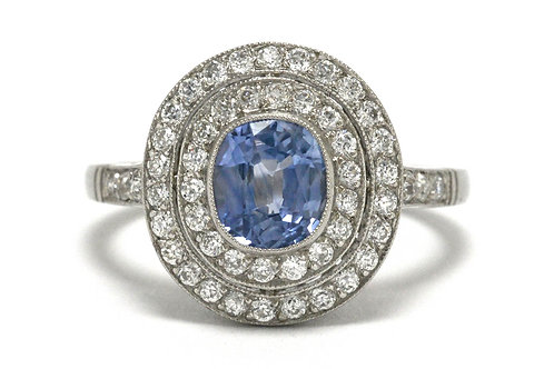 A ceylon blue sapphire with a double diamond halo engagement ring