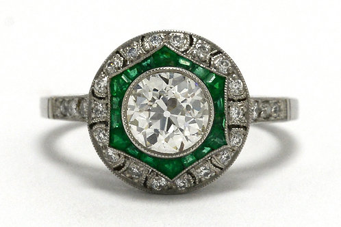 An old mine brilliant diamond emeralds halo star engagement ring