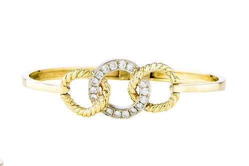 A modernist gold diamond white and yellow gold bangle bracelet