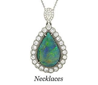 A teardrop opal diamond halo pendant necklace.