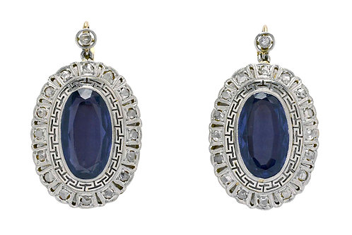 Art Deco oval violet hue amethyst earrings surrounded by a halo of diamonds