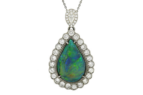 A black opal diamond halo platinum pendant necklace Edwardian