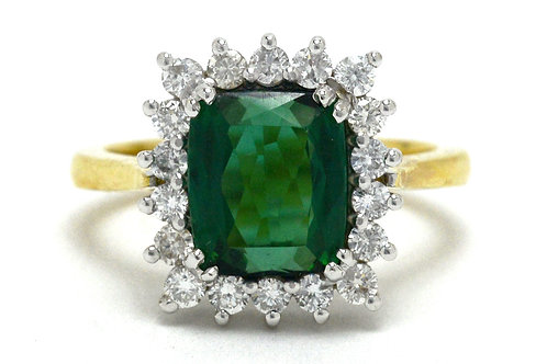 An antique cushion tourmaline diamond halo engagement ring
