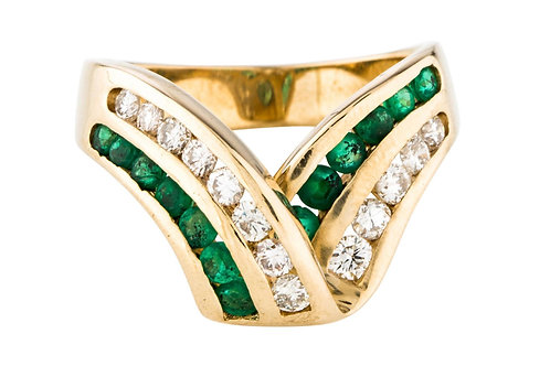 A modern design gold statement band with 2 rows of emeralds and diamonds