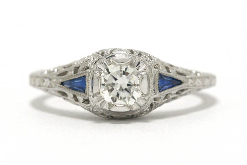 A round brilliant diamond 18K white gold engagement ring