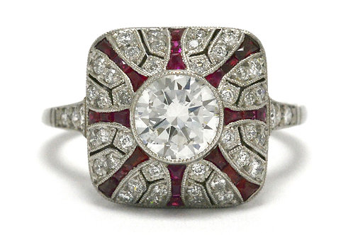 A diamond engagement ring ruby lines starburst hand made platinum design