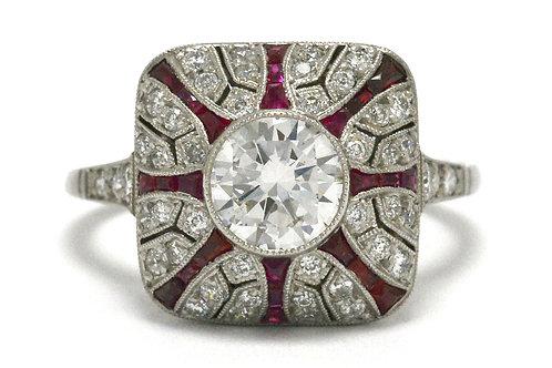 A diamond engagement ring ruby lines starburst hand made platinum design