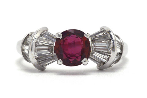 A an oval ruby bow engagement ring with diamond baguette accents
