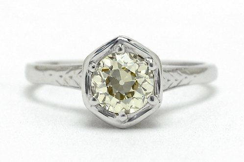 A hexagon white gold diamond solitaire engagement ring