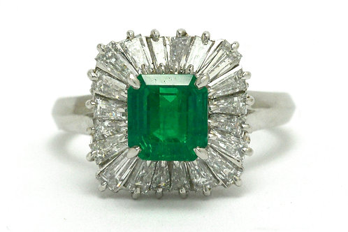 A square emerald target ring accented by baguette cut diamonds