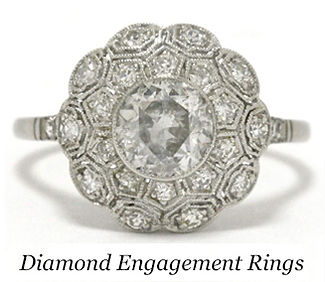 A diamond cluster engagement ring featuring platinum flower petals in this fine piece of estate jewelry