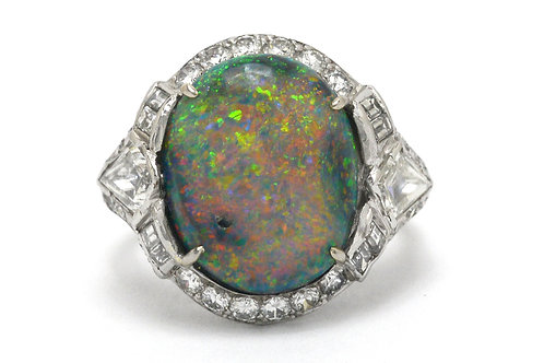 A Lightning Ridge opal is surrounded by diamonds in this stunning platinum statement ring