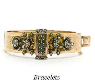 An old Victorian rose gold cuff bracelet of emeralds and pearls with slide lock fastening