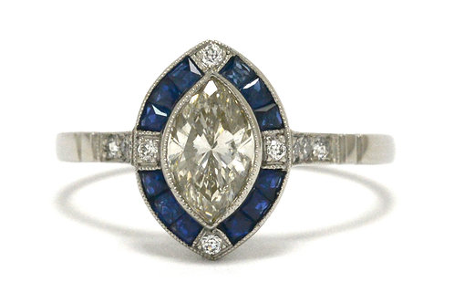 A platinum marquise center diamond Art Deco ring