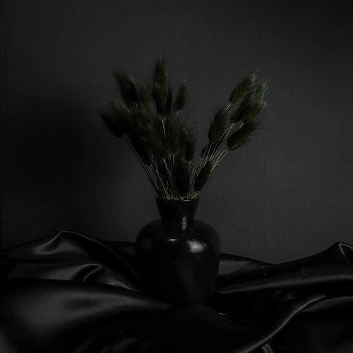 Black Rabbits in Black Wood Vase