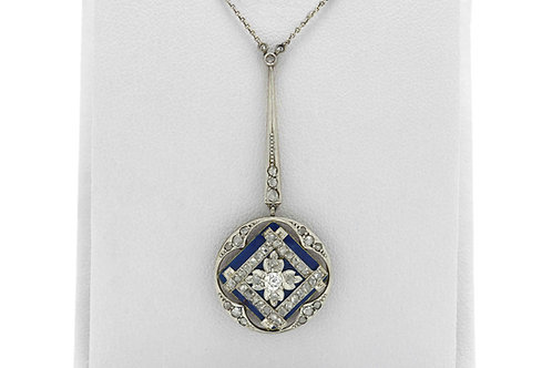 An antique diamond drop necklace with blue enamel accents