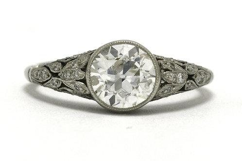 An old mine cut diamond engagement ring platinum Art Nouveau solitaire