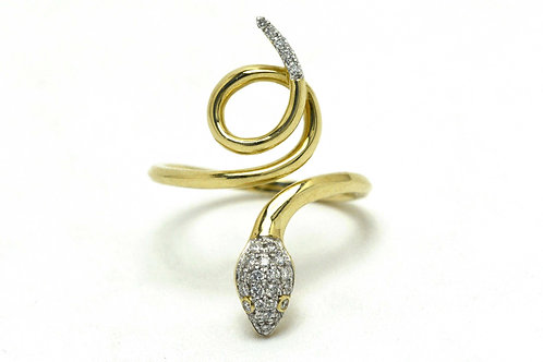 A diamond snake ring in 14k yellow and white gold