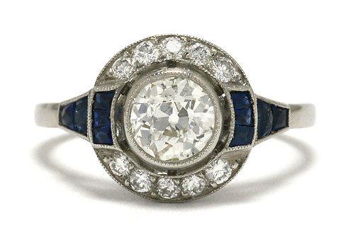 An antique old mine cut diamond engagement ring with blue sapphire accents