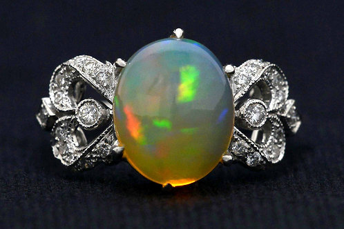 Oval opal diamond bow engagement ring