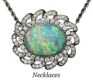This oval cabochon opal necklace is surrounded by halo of diamonds