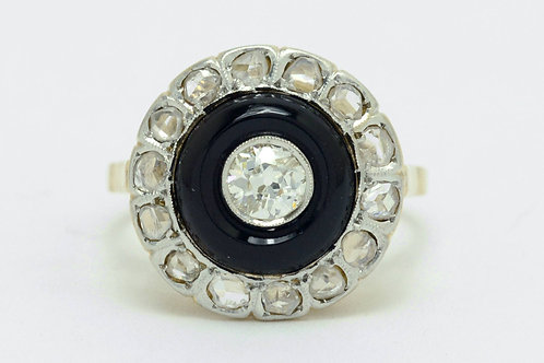 A platinum top onyx and diamonds halo engagement ring