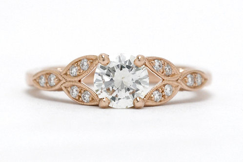 A rose gold Art Deco revival diamond engagement ring