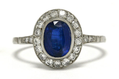 An Edwardian diamond halo platinum engagement ring