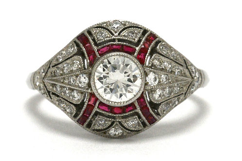 An Edwardian engagement ring featuring a round brilliant diamond