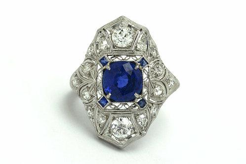 An Edwardian platinum blue sapphire engagement ring