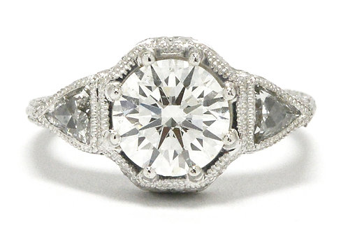 GIA certified near colorless round brilliant diamond engagement ring