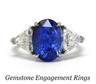 A sapphire diamond 3 stone engagement ring.
