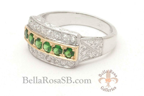 A green tsavorite anniversary band with diamond accents